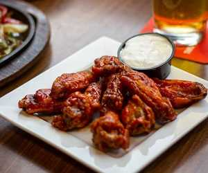 $7 One pound of wings and $6.50 Stella Draught - Tuesday & Thursday